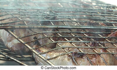 Grill. - HD 1080 closeup clip of preparation of the grill...