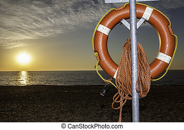 buoyancy aid on beach at sunrise - Clear view of a lifesaver...