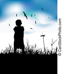 Little boy on summer field, silhouette on blue sky