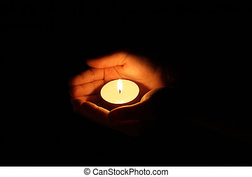 palms - Hands cupped around a candle