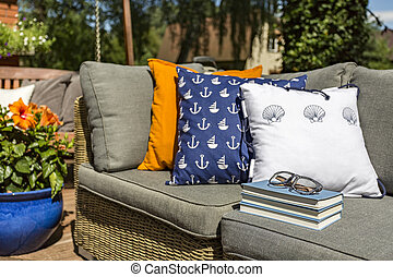 Relax with book in the garden - Image of pattern pillows...