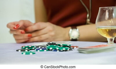 casino chips on white table close up
