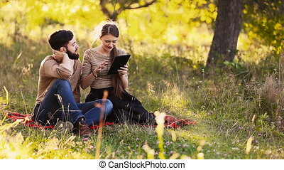 young couple with a tablet - Young couple with tablet...
