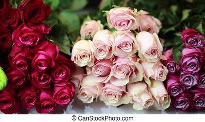 Women's hands are take a pink Roses at the storefront. HD.