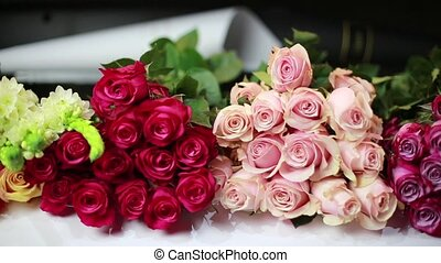 Bouquets of roses lay on the counter in the store. HD.