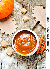 pumpkin butter on wood background. toning. selective focus