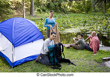 Hispanic family camping - Hispanic family with two boys...