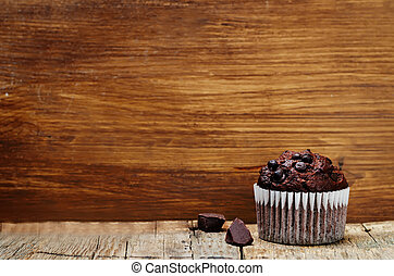 chocolate chips, chocolate muffin. toning. selective focus