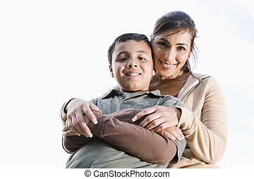 Portrait of Hispanic mother and son outdoors - Portrait of...