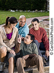 Portrait of Hispanic family outdoors - Portrait of Hispanic...