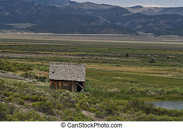 Old shack - An old shack on a meadow in the mountains.