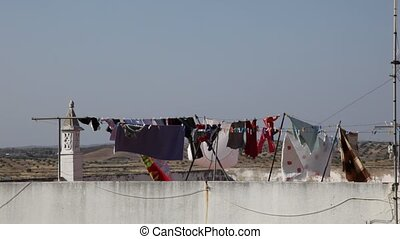 Washed clothes drying in the sun. Typical scenery for...
