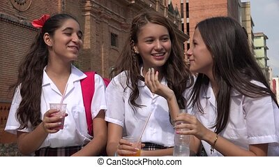 Teen Girls Drinking Beverages