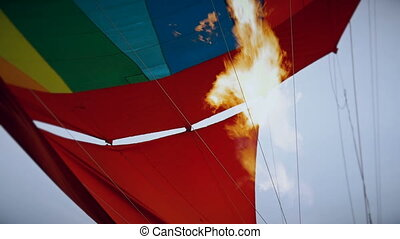 Hot air burning to the air balloon during the flight HD