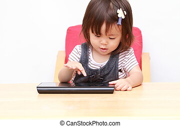 Japanese girl using a tablet PC 1 year old