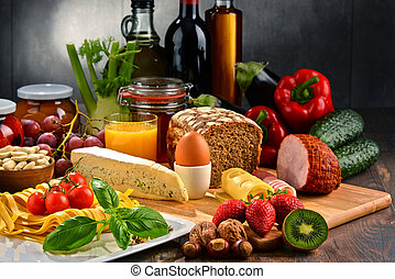Composition with variety of organic food products on kitchen...