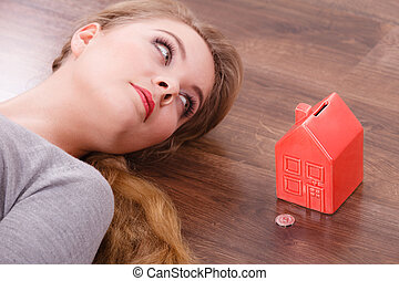 Woman lying with cash box.