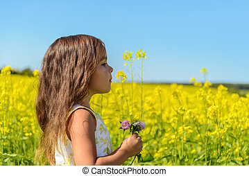 Portrait of a girl in rapeseed field (Green Gables Shore,...