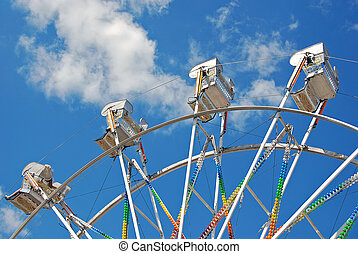 Ferris wheel ride with clouds - Ferris wheel ride in...