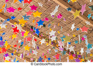 Stars made from candle for decoration on roof ceiling.