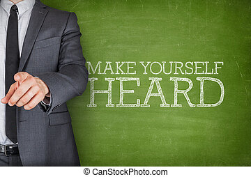 Make yourself heard on blackboard with businessman - Concept...