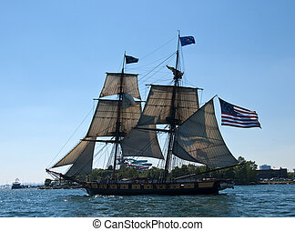 tall ship with american flag - tall ship sailing flying an...