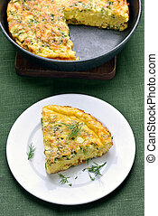 Piece of omelette on plate - Piece of omelette with herbs,...