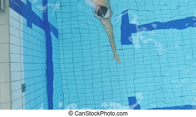 Man Swimming in Pool