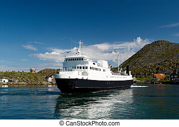Ferry at the island Skrova - The ferry in a fjord of Norway