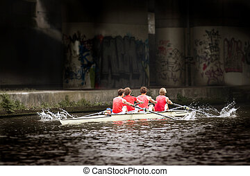 Rowing team - Top sport rowing team coxed four emerging from...
