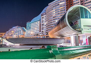 Darling Harbour - Sydney. Beautiful skyline at sunset with subway terminal