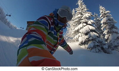 Snowboarder rides deep powder - Snowboarder rides through...