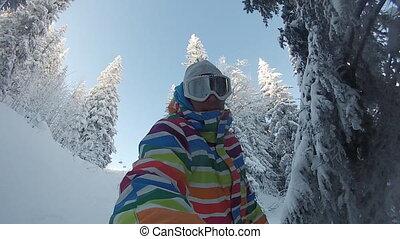 Snowboarder rides deep powder