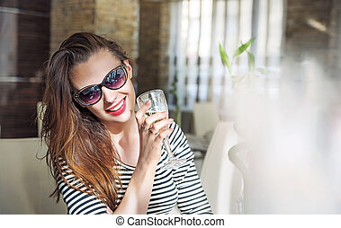 Closeup portrait of a young female customer drinking white...