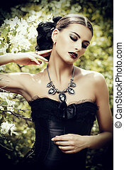 precious necklace - Beautiful brunette woman in long black...
