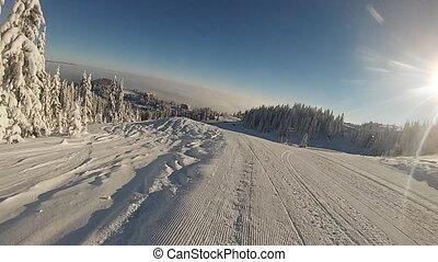 Snowboarder rides deep powder - Snowboarder rides through...