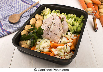 chicken with mixed vegetables in a roasting tray