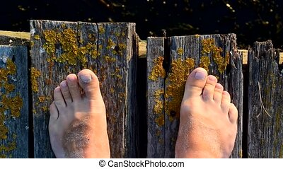 Bare feet on wooden boards with moving toes - Bare feet on...