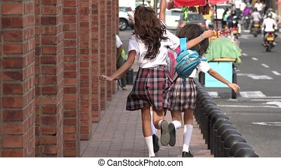 School Girls Running On Sidewalk