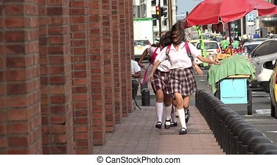 Teen Girls Running On Sidewalk
