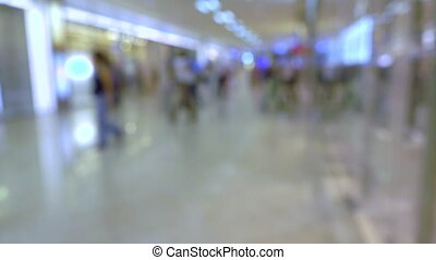 Blurred people walking in modern shopping mall. 4K...