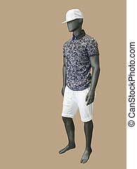 Male mannequin dressed in shirt and shorts