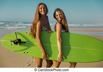 We love surf - Best friends enjoying the summer, posing with...