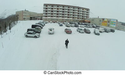 Car Parking by the Big Hotel - KUUSAMO, FINLAND - JANUARY 6,...
