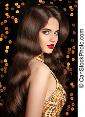 Long hair Brunette girl with shiny wavy hairstyle and red...