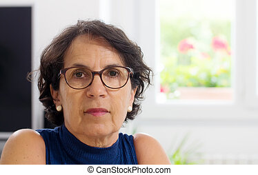 portrait of a mature woman with glasses - portrait of a...