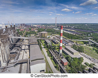 Steel factory with smokestacks at suny day.Metallurgical...