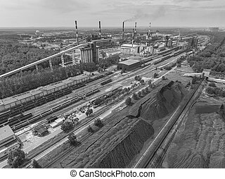 Steel factory with smokestacks at suny dayMetallurgical...