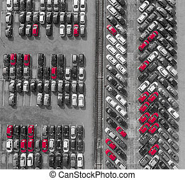 Aerial view lot of vehicles on parking for new car. Black...