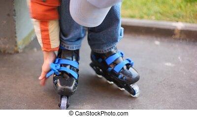 boy puts on roller skates